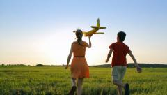 Happy children with a model aircraft Stock Footage