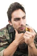 Distraught military soldier veteran ptsd drinking a shot of liquor Stock Photos