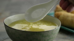 Close-up of soup being mixed with spoon Stock Footage