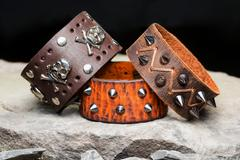 Bracelets with spikes and skulls Stock Photos