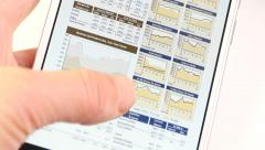 4k Businessman browsing financial news on smartPhone,finger touching finance. Stock Footage