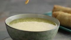 Stock Video Footage of Crisp falling in soup in slow motion