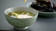 Stock Video Footage of Crisp falling in wonton soup