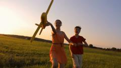 Stock Video Footage of Happy children with a model plane, careless