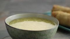 Crisps falling in soup - stock footage