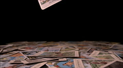 Death tarot card falling on scattered cards Stock Footage