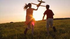 Stock Video Footage of Happy children with a model aircraft, careless