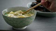 Stock Video Footage of Wontons being removed with chopsticks from bowl of soup