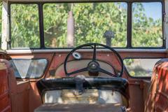 Antique tractor cab with steering wheel Stock Photos