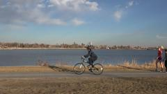 Bike Rider in front of Scenic Lake Stock Footage