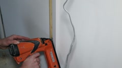 Carpenter using a nailgun Stock Footage