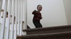 A toddler walking down the stairs Stock Footage