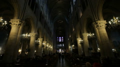 PARIS, FRANCE - NOVEMBER 2010: Interior of the Notre-Dame Cathedral in Paris Stock Footage
