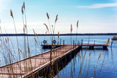 Dock for pleasure and fishing boats Stock Photos