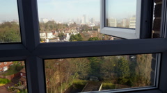 City view, camera tracking through a window. Stock Footage