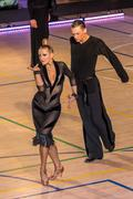 Competitors dancing latin dance on the conquest - stock photo