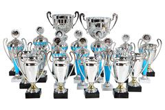 set premium silver cups on marble base, isolated on white - stock photo