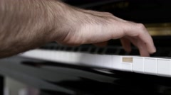 Man playing music on a piano inside his home Stock Footage