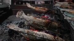 Fish fried on a grill, cooking,  rotating. Asia Food Sea Vacation Holiday Dinner Stock Footage