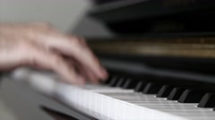 Hands playing jazz on a piano inside his home Stock Footage