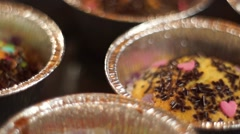 Decorating muffins panning Stock Footage