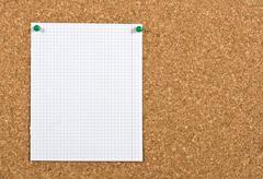 Empty sheet on a corkboard Stock Photos