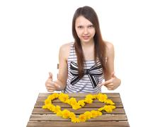 Caucasian teen girl, 15 years old, shows a yellow valentine. Stock Photos