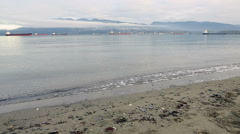 English Bay Beach, Vancouver, Morning dolly shot Stock Footage