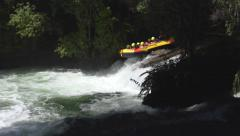White water rafting and over a waterfall Stock Footage