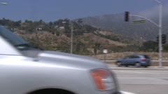A car travels along Pacific Coast Highway as seen through the side window. Stock Footage