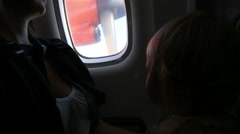 little child surprised by vibration during the flight in the airplane - stock footage
