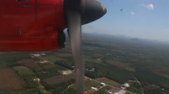 Rotation of airplane propeller flying above tropical plantations Stock Footage