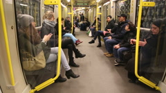 BERLIN, GERMANY: Passengers sitting in the U-Bahn wagon as it jolt and turns. Stock Footage