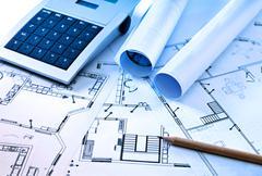 Blueprints and Calculator Stock Photos