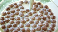 Healthy Breakfast with Chocolate Cereals in Milk in Bowl Stock Footage