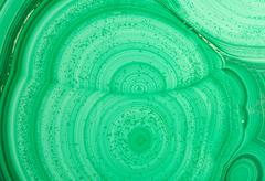 Detail of the polished slab of layered green malachite - stock photo