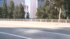 A car travels along a street in Century City, Los Angeles as seen through the Stock Footage