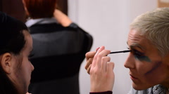 Girl being made up in a backstage of actors in a theater. Stock Footage
