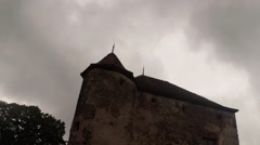 Tower of the old castle fortress on a background of gloomy sky Stock Footage