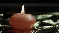 Ungraded: Candle Close-Up on Shiny Background Stock Footage