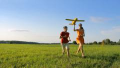 Children dreaming, holding a plane Stock Footage