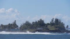 Island pounded by waves Stock Footage