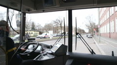 View from inside of bus with driver and Berlin traffic to Tegel airport. Stock Footage