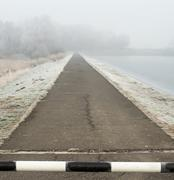 Stock Photo of road to far away with barrier on freeze landscape