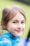 Portrait of a happy little cute girl - stock photo