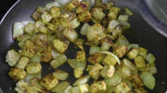 Leek Pepper being added to the pan/skillet - stock footage