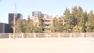 Stock Video Footage of A car travels along Avenue of the Stars in Century City, Los Angeles as seen