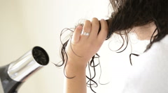 Woman Using Hairdryer Stock Footage