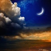 Sunset and new moon - stock photo