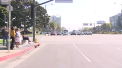 A car travels along a street in Century City, Los Angeles as seen through the - stock footage
